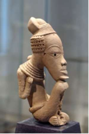 NOK TERRACOTTA ACQUIRED ILLEGALLY BY FRANCE -Seated person. Nok cultural object, 500 BC - 500 AD. Quai Branly, depot of Louvre, inv. No. 70. 1998.11. One of the three stolen items from Nigeria now in Paris, with the agreement of the Nigerian Government.